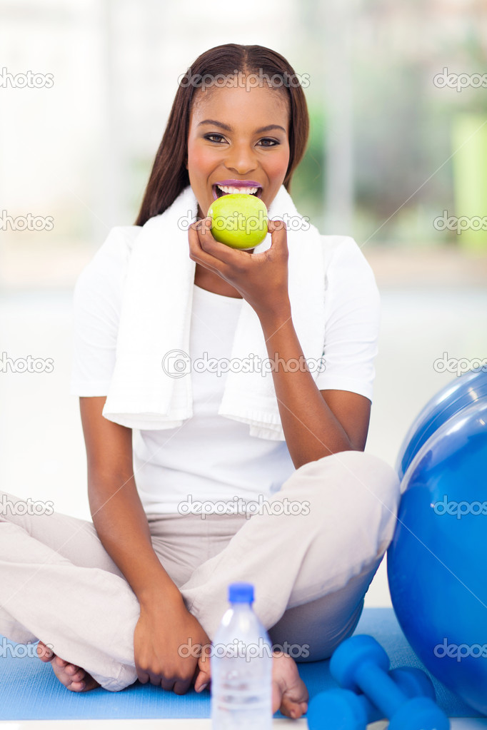 young african american woman eating apple
